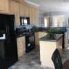 The Maria model kitchen with modern black appliances and a central island